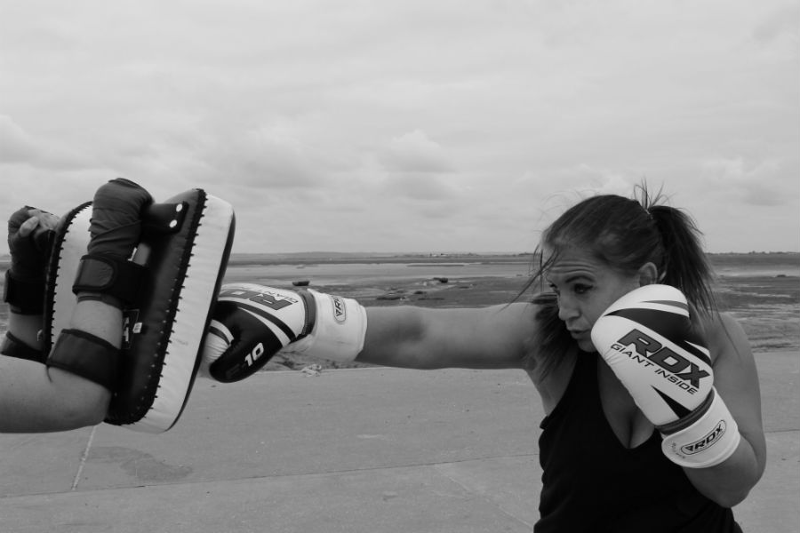 Lisa punching Muay Thai pad on Bell Wharf in Leigh on Sea.
